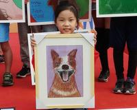 "The girl with her ""Happy dog"" painting that inspired it all"