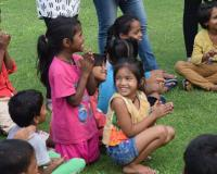 Children from Sanjay Gandhi Camp enjoying the presentations by the REC graduates. Photo: Bhavya Taneja