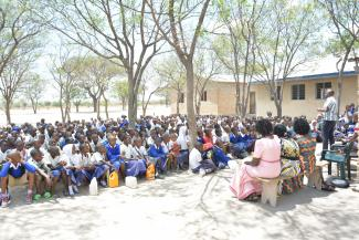 A school program later that day to raise awareness on rabies, Maganga sambo is explaining how one can avoid dog bite
