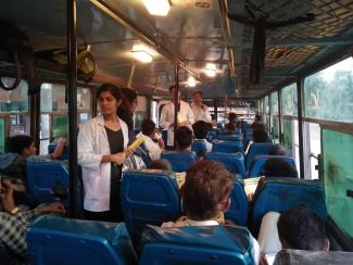 Students distributing pamphlets in the public transport bus and giving brief information regarding prevention of rabies after dog bite.