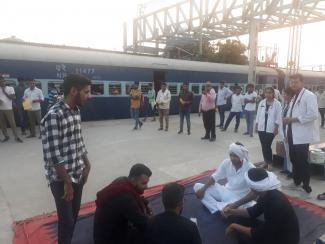 Graduate students performing street show on the theme Rabies: Vaccinate to eliminate at Railway sation