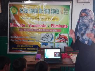 Speaker teaching rabies information to students
