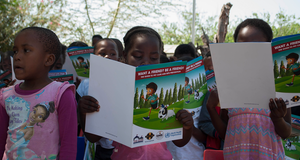 Children reading educational booklets